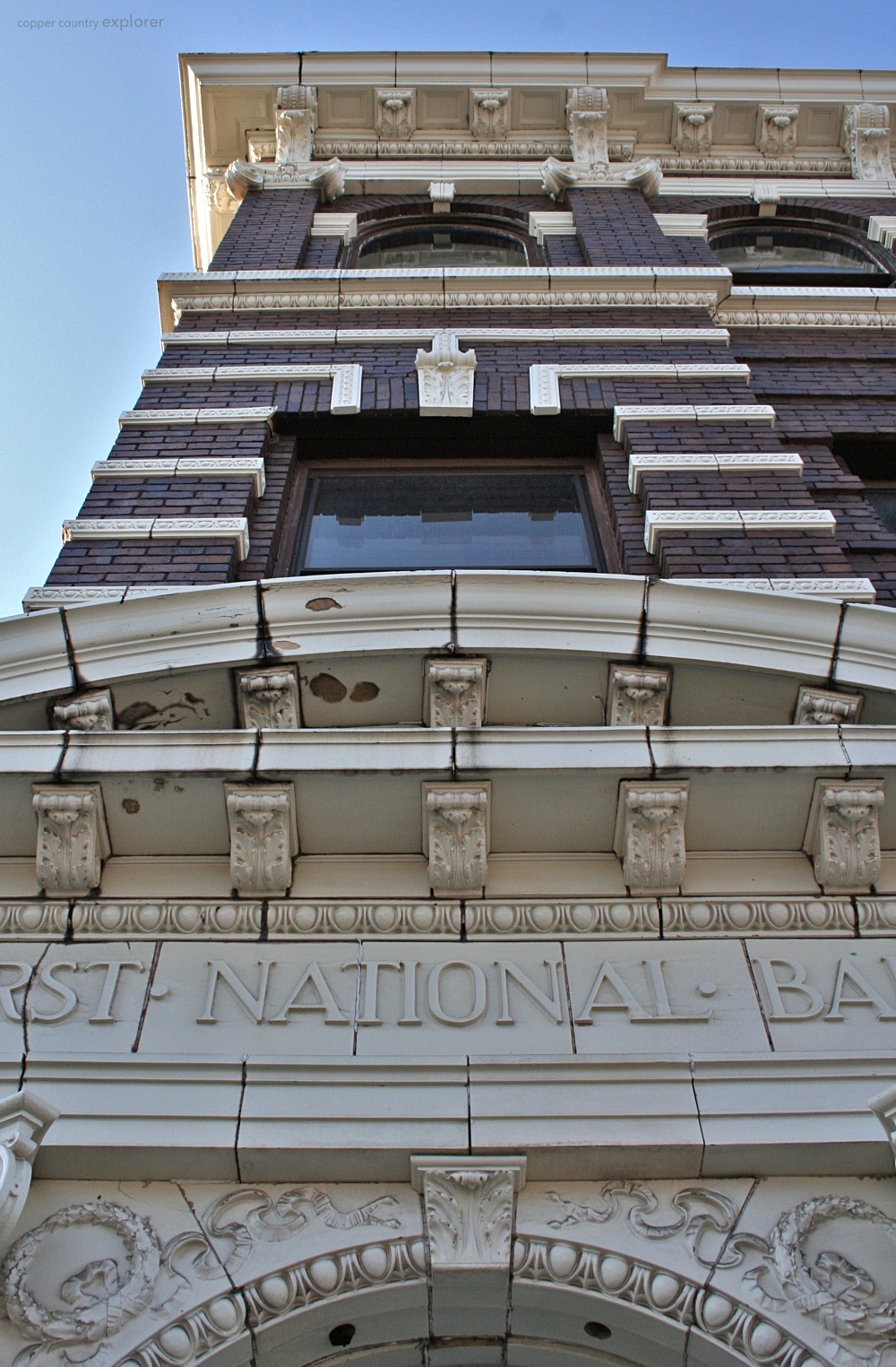 Looking up the Facade of the First National Bank Building of Laurium